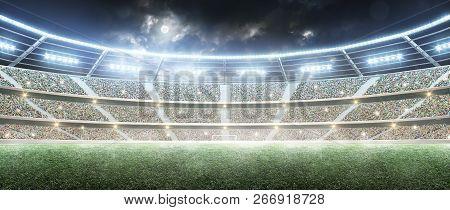 Soccer Stadium. Professional Sport Arena. Night Stadium Under The Moon With Lights. Panorama