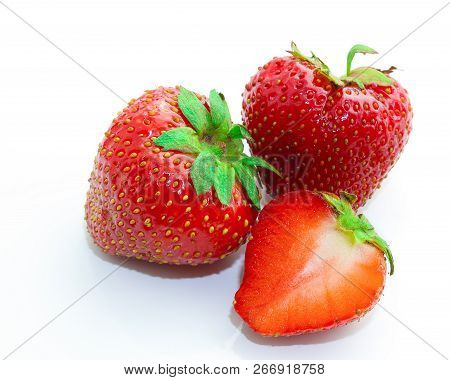 Red Berry Strawberry Isolated On White Background. Slices Of Strawberry On White. Juicy Strawberries