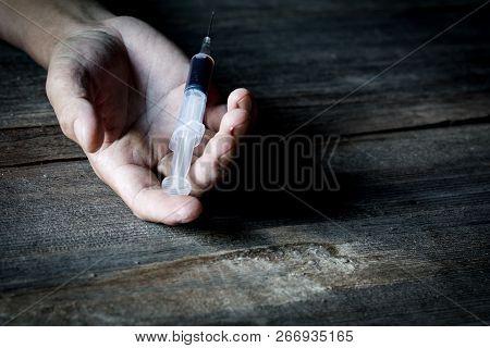 Drug Abuse Concept, Overdose Male Drug Addict Hand, Drugs Narcotic Syringe In Hand On The Floor