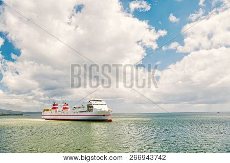 Cargo Ship. Modern Cargo Ship At Sea In Sunny Day With Blue Sky And Cloud. Transportation Concept. I