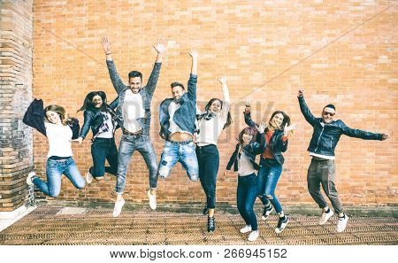 Happy Friends Millennials Jumping And Cheering Against Brick Wall In The City - Friendship Lifestyle
