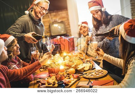 Friends Group With Santa Hats Celebrating Christmas With Champagne And Sweets Food At Home Dinner -