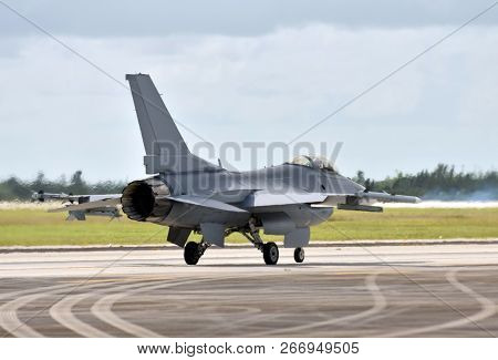 Modern Fighter Jet Airplane Taxiing For Departure On A Mission Rear View