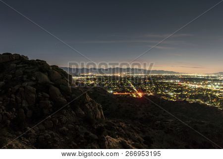 Los Angeles California early morning view of the San Fernando Valley from the Santa Susana Mountains.  The San Gabriel Mountains are in background.