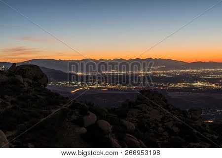 Los Angeles California dawn mountain view of Porter Ranch in the San Fernando Valley.  The San Gabriel Mountains are in background.