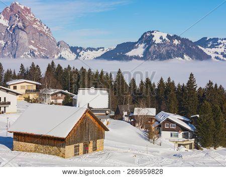 Village Of Stoos In The Swiss Canton Of Schwyz In Winter, The Grosser Mythen Summit In The Backgroun