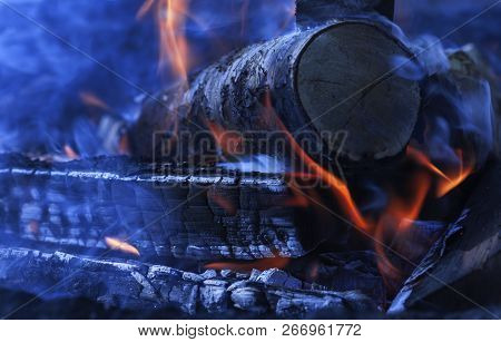 Firewood On Fire, Flames. Smoke And Open Fire. Dark Background.