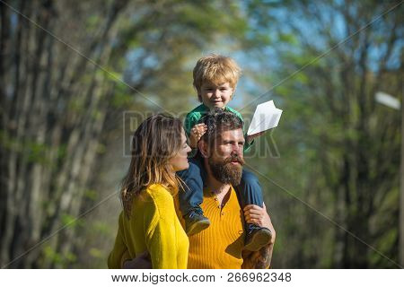 Family Relationship. Wife And Husband With Little Baby Son Enjoy Sunny Day In Park, Genetic Relation