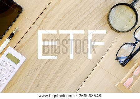 Business And Finance Concept. Top View Of Stationary On Wooden Background Written With Etf(exchange