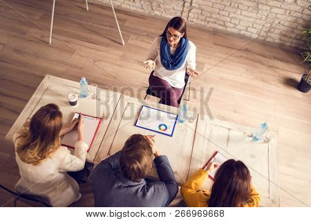 Young female with commission in company having job interview