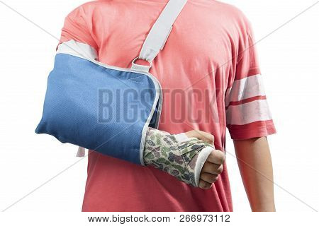 Man With Broken Bone Arm Using Cast And Sling For Treatment Isolated Over White Background