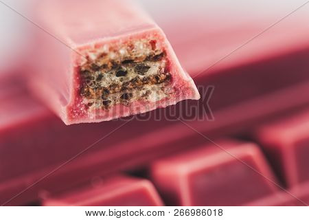 Finger Ruby Chocolate Bar Made From Ruby Cocoa Bean. New Dimension Of Chocolate Sweets.