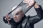 Who wants to play. Transgender man cover face with fishnet. Male makeup look. Fetish fashion. BDSM fashion accessory. Heterosexual man with male makeup. poster