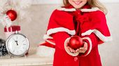 Kids can brighten up christmas tree by creating their own ornaments. Christmas ball traditional decor. Top christmas decorating ideas for kids room. Child red costume hold christmas ornament ball poster