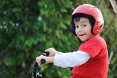 Young boy riding bicycle, shallow dof poster
