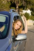 Road rage angry annoyed young woman in car poster