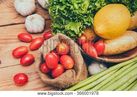 Fresh Organic Vegetables On Wood Background For Cooking Salad. Diet And Healthy Food. Fall Harvest C