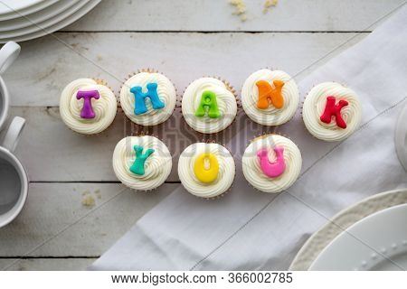 Cupcakes with thank you written in rainbow colors