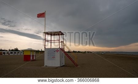A Red And Yellow Dangerous Swimming Warning Lifeguard Flag.