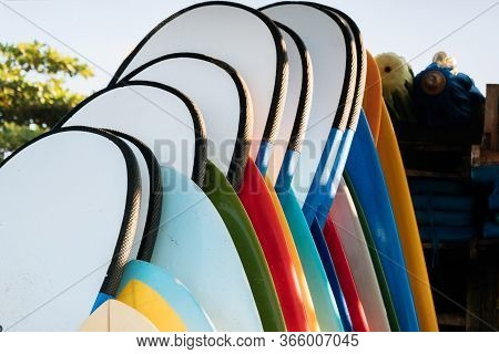 Close Up Set Of Colorful Surfboard For Rent On The Beach. Multicolored Surf Boards Different Sizes A