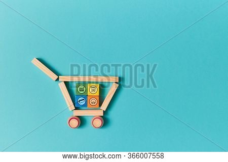 Delivery Service. Food Ordering And Food Delivery. Copy Space. Shopping Cart Made Of Wooden Blocks.