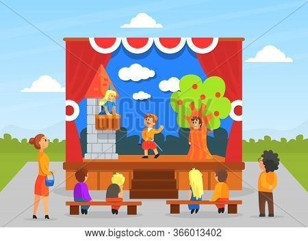 Children Theatre Performance, Kids Actors Performing On Stage With Red Curtains And Fairy Tale Castl