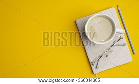 Flat Lay, Top View Office Table Desk. Modern Workplace With Cup Of Coffee, Notebook, Glasses, Pencil