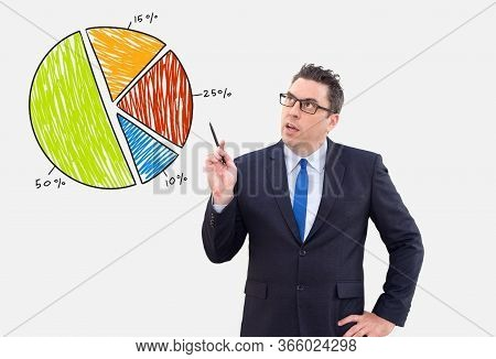 Male Analyst Thinking Of Sales With Drawing Pie Chart. Pensive Handsome Businessman Working On Proje