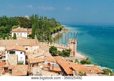 Aerial View To The Harbor Of Sirmione From The Tower Of Scaliger Castle With Lake Garda In Backgroun