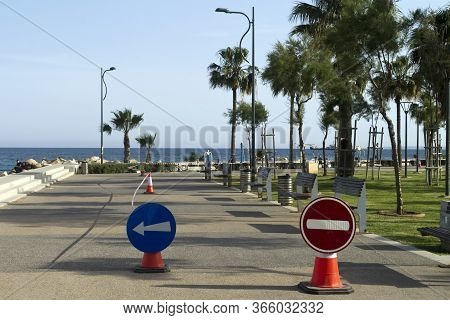 Limassol, Cyprus, May 11th, 2020: Seafront Promenade Molos During Coronavirus Quarantine With Warnin