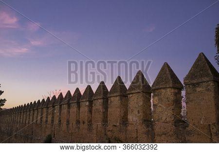 Cordoba Muslim City Walls Battlements At Sunset.