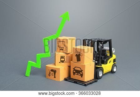 Forklift With Boxes And Green Arrow Up. Economic Recovery And Increased Trade And Freight Traffic. I