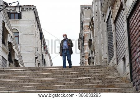 Venice, Italy-may 10, 2020:elderly Man In Protective Medical Mask On The Rialto Bridge In Venice. Co