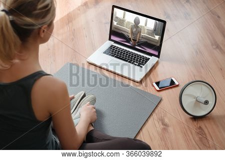 Yoga Teacher Conducting Virtual Class At Home On A Video Conference. Young Beautiful Woman Doing An