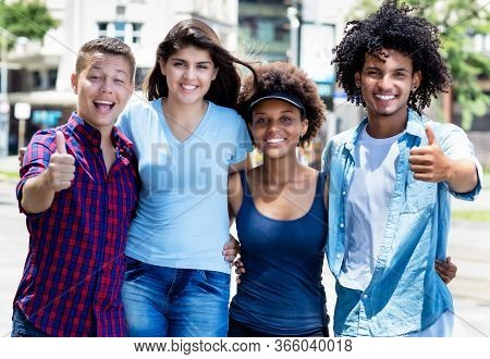 Group Photo Of Hispanic And Caucasian And African American Young Adults In Summer In City