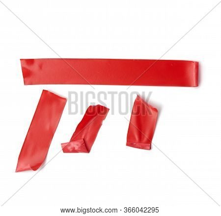 Various Pieces Of Red Insulating Rubber Tape Isolated On A White Background, Close Up