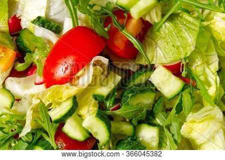 Vegetarian Vegetable Salad. Summer Vitamin Salad. Homemade Salad, Croutons, Tomatoes, Greens Close-u