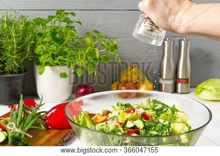 Salad From Fresh Vegetables In A Plate On A Table. Bowl Of Salad With Vegetables And Greens On White