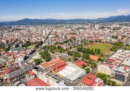 Nantou, Taiwan - October 30th, 2019: aerial view of Puli town with buildings under blue sky, Nantou, Taiwan