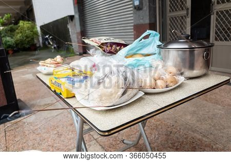 Nantou, Taiwan - August 15th, 2019: Taiwanese people put pork, drink and snacks on a table for the