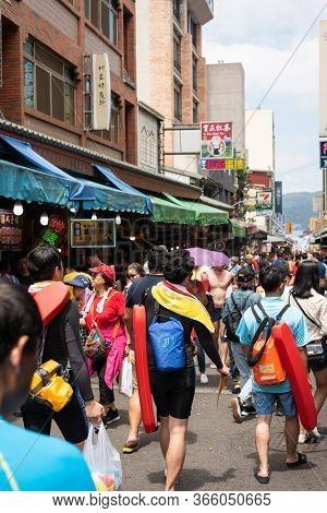 Nantou, Taiwan - September first, 2019: people walk at the marketplace street at Sun Moon Lake Swimming Carnival, Nantou, Taiwan
