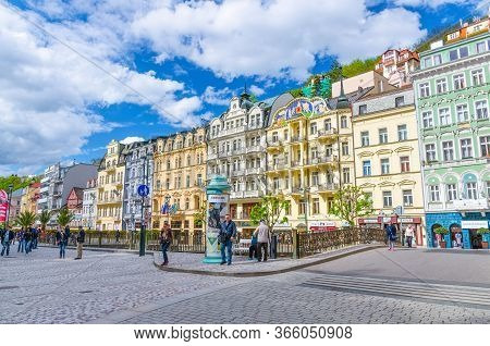 Karlovy Vary, Czech Republic, May 9, 2019: People Are Walking Down Street And Tepla River Embankment