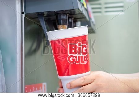 Bangkok, Thailand - May 10, 2020: 7-eleven Big Gulp Cup Gets Filled With Coca-cola With A Soda Machi