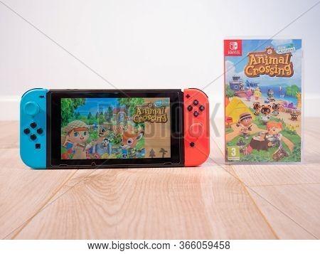May 2020, Uk: Nintendo Switch Console And Animal Crossing New Horizons Bundle On White Studio