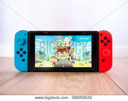 May 2020, Uk: Nintendo Switch Console New Moving Out Game By Team 17 Studio On White Background