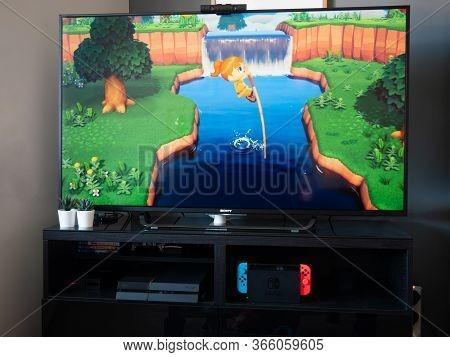 May 2020, Uk: Nintendo Switch Animal Crossing New Horizons Character On Tv Monitor