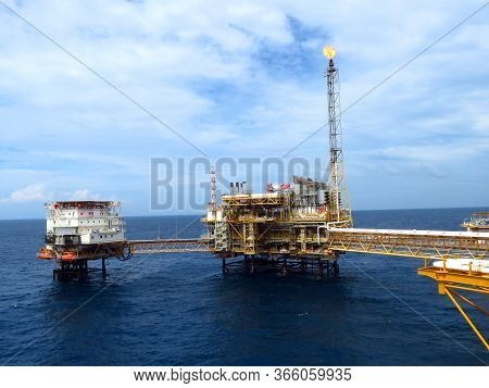 Offshore Oil And Rig Platform. Construction Of Production Process In The Sea. Power Energy Of The Wo