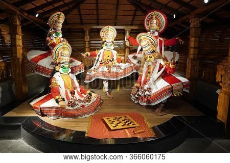 Kathakali Performers During The Traditional Kathakali Dance Of Kerala's State In India. It Is A Majo