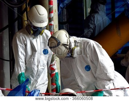 Songkhla Province , Thailand: Feb 20, 2014: Man With Protective Mask And Protective Clothes In Dange