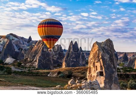 Colorful Hot Air Balloons Flying Over The Valley At Cappadocia, Anatolia, Turkey. Volcanic Mountains